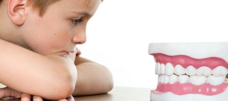 из-за чего происходит скрежет зубами во сне у детей