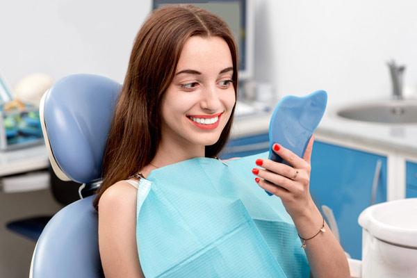Сколько стоит вырвать и вставить несколько передних зубов