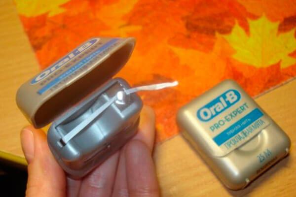 как пользоваться зубной нитью орал би