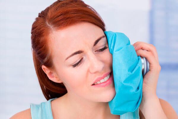 болит десна над зубом при нажатии после удаления нерва