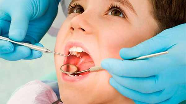 Разрушение эмали зубов у детей симптомы