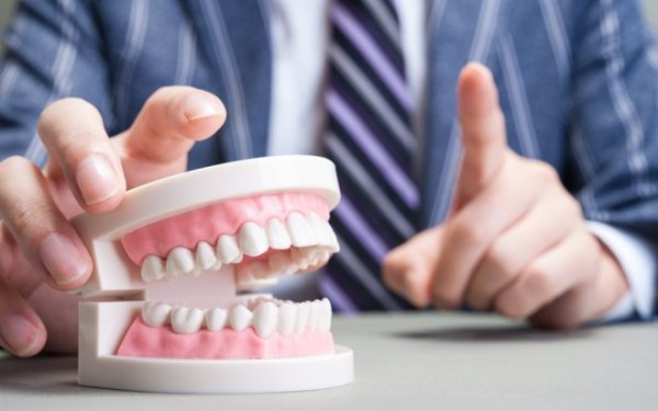 Формы стирания твердых тканей зубов
