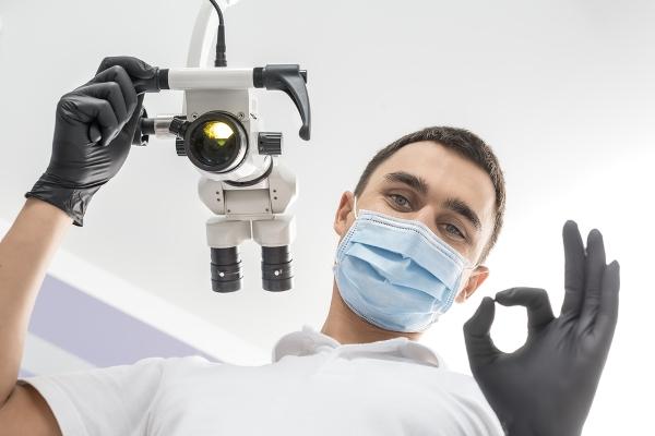 Лечение зуба под микроскопом цена