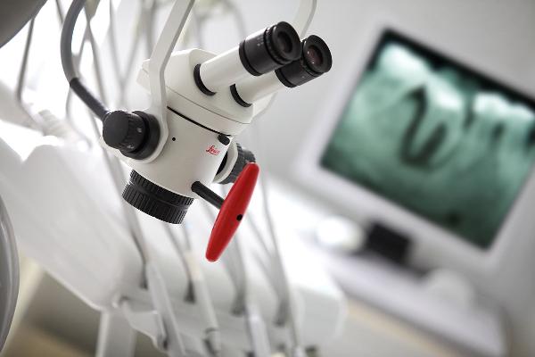Лечение кисты зуба под микроскопом