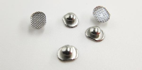 Кнопки в ортодонтии